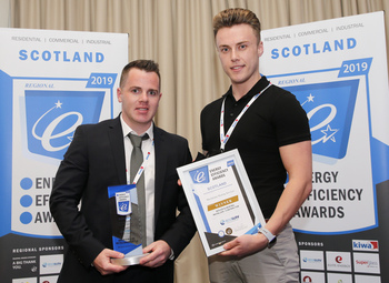 Prize being presented to Macfarlane Heating Services